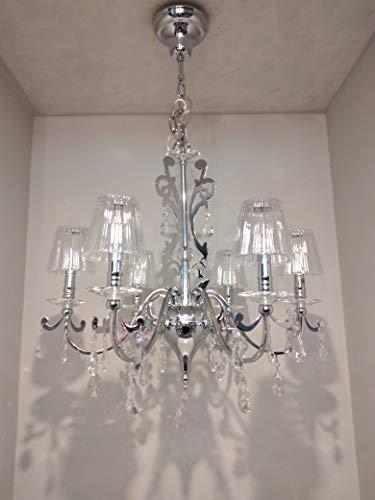Lámpara modelo Forest iluminada. Estructura de metal cromado brillante y elementos de cristal. Tulipa y colgantes de cristal. 6 x G9 máx. 40 W MIS 62,5 x 1,20 h máx. Bombillas no incluidas.