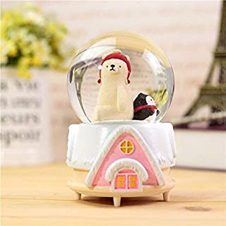 Cute polar bear in the rotating crystal ball box for interesting small toy as a small gift