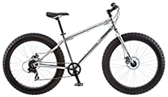 Mongoose Supersized beach cruiser 26 inches  X 4 inches knobby tires Cruiser design frame with plenty of clearance to conquer any terrain Alloy 4 inches wide wheel set with disc brakes 7 speed gearing with Shimano rear derailleur 3 piece cranks and b...