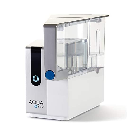 AquaTru - Countertop Water Filtration Purification System with Exclusive 4-Stage Ultra Reverse Osmosis Technology (No… 7 IS YOUR WATER SAFE TO DRINK? Studies continue to pour in regarding Toxins, Hormones, Microplastics, Cancer-linked contaminants, known Carcinogens and other toxins discovered in our Tap Water, Filtered Water…and yes, even Bottled Water. Arsenic, lead, chromium, and drug residues are commonly found in municipal drinking water. AQUA TRU's patented Ultra Reverse Osmosis water filtration system is CERTIFIED to remove such contaminants and many more! Tested and certified by IAPMO according to NSF/ANSI standards to remove 82 CONTAMINANTS - that's 15X more contaminants than the leading pitcher filters. Removes such toxins as Lead 99.1%, Chromium 97.2%, Copper 95.2%, Fluoride 93.5%, Radium 96.4%, and Chlorine 96.6% (to name a few). In fact, it's designed to remove 1000's of pollutants that could be lurking in your tap water. Taste the Difference! NO PLUMBING OR INSTALLATION required - takes just minutes to set up. AquaTru's Trusted & warrantied RO countertop system COSTS CONSIDERABLY LESS than fully installed under-the-counter RO systems, while at the same time, delivering often Cleaner, Purer, and Better Tasting Water. Why waste money & add to landfills with bottled water (93% recently found to contain micro-plastics)? 1 SET OF FILTERS REPLACES 4500 PLASTIC WATER BOTTLES (16.9 oz) - Forget about the hassle & cost of buying bottled water