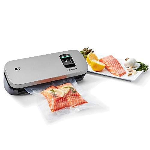 FoodSaver VS1190X - Envasadora al vacío de alimentos compacta con accesorio sellador manual, 1rollo pequeño y 5bolsas pequeñas, color plata con detalles negros
