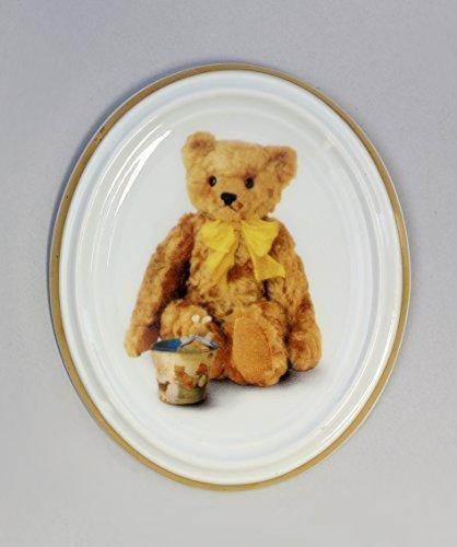 Médaillon en porcelaine avec motif ours