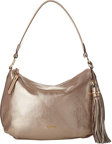 Enjoy a look of sheer elegance with the Calvin Klein® Holly Dusted Suede Hobo handbag at your side! Metallic faux-leather construction. Zipper closure. Shoulder strap. Exterior boasts brand detail, tassel decor, and zipper pocket. Flat bottom. Lined ...