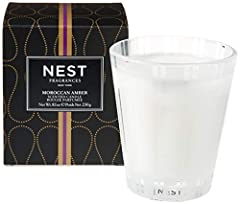 Classic Candle 230 g / 8.1 Oz. NEST Fragrances Moroccan Amber Classic Candle includes notes of moroccan amber, sweet patchouli, heliotrope and bergamot that are accented with a hint of eucalyptus. The glass vessel is designed to compliment the beauty...