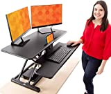 Stand Steady FlexPro Hero Power | Electric Standing Desk Converter/Desk Riser with Wireless Charging | Turns Any Desk into a Sit to Stand Up Desk | Integrated Phone/Tablet Holder (37.5 Inch / Black)