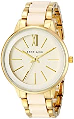 Boyfriend-style watch with slender hour markers featuring printed logo at center dial and ivory resin center links on bracelet 37 mm metal case with mineral dial window Japanese quartz movement with analog display Resin and gold-tone band with jewelr...
