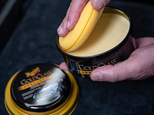 Man holds black can containing Meguiars Gold Class Paste Wax