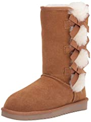 Fixed, decorative bows Exposed sheepskin Combination sheepskin/faux fur lining and insole Thinsulate sockliner