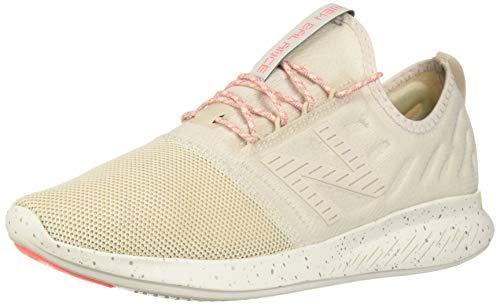 New Balance Women's FuelCore Coast V4 Running Shoe, Moonbeam/Dragonfly, 10.5 B US