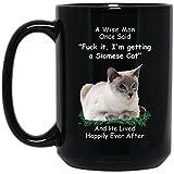 n\a divertente gatto siamese occhio azzurro un uomo saggio una volta disse una tazza di caffè nero