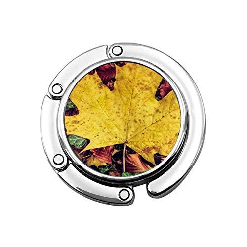Netter Faltbarer Geldbeutel-Aufhänger-Haken für Tisch, gelbe Ahorn-Handtaschen-Haken-Tisch-Tasche
