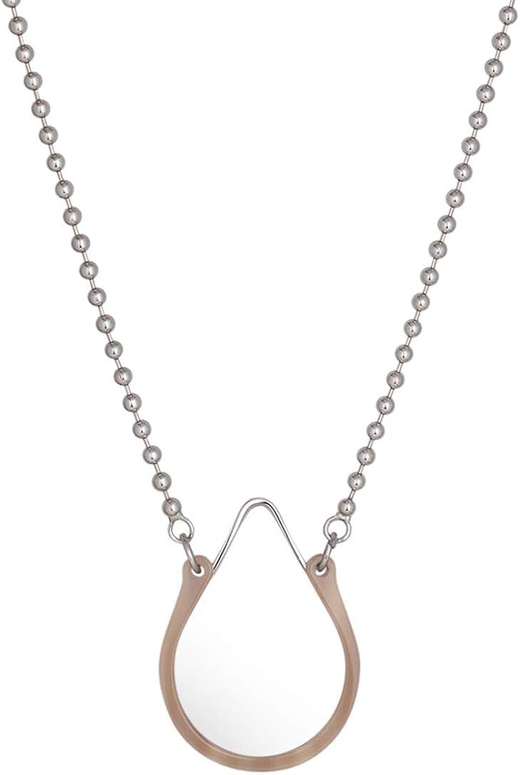 LUKA : Café De Flore. Monocle necklace with magnifying optic lens.
