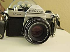 The Pentax K1000 35mm SLR is one of photography's greatest, most popular and longest-lived cameras. This Pentax film camera is completely mechanical and needs no battery to run, however, you must purchase an A76 cell battery to run the light meter. U...