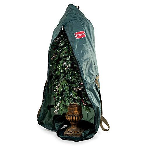 green artificial Christmas tree storage bag over a Christmas tree.