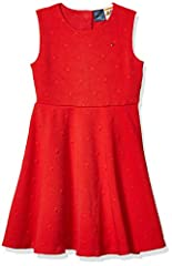Designed with and for people with disabilities. Tommy Hilfiger girls' dress. All-over stars enliven an otherwise ordinary sleeveless dress. Added bonus? Dressing time is all-too easy thanks a hidden magnetic closure down the center back. More adaptiv...