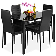 GLASS TABLETOP: Modern and sophisticated, this 5-piece set includes a table with a glass top for an elegant touch and smooth surface to place food & drinks HIGH QUALITY: Durably made of a rust-resistant, steel frame and chairs with padded faux leathe...