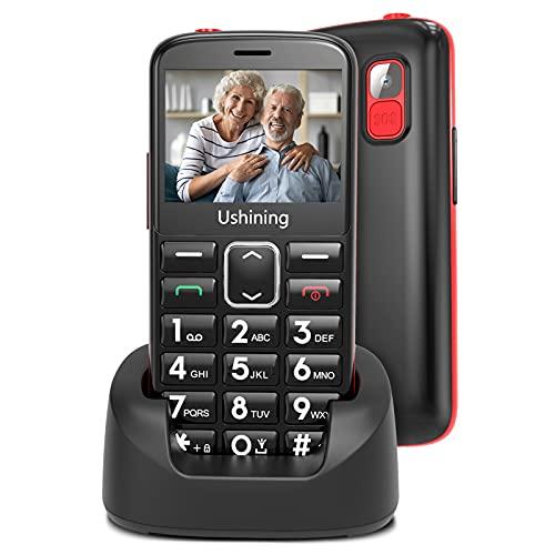 USHINING 3G Seniorenhandy ohne Vertrag mit Großen Tasten, Ladestation Notruftaste Dual-SIM 1000 mAh Akku Lange Standby-Zeit 2,4 Zoll Farbdisplay Hörgeräte Kompatibel - Schwarz