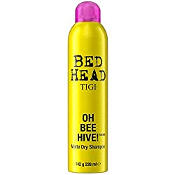 A bottle of dry shampoo which is a popular travel gift.