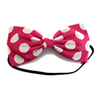 White and Hot Pink polka dot rombo braided strap with a bow attached