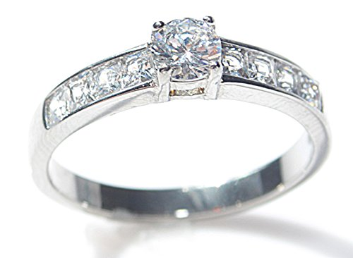 MASSIVE BLOW OUT SALE! DEFINITE MUST HAVE! DO NOT MISS OUT! APPEALING Stainless Steel Princess Cut Ring Made With SPARKLING SIMULATED DIAMONDS. BOLD AND EYE CATCHING BRILLIANT ROUND CENTRE STONE.
