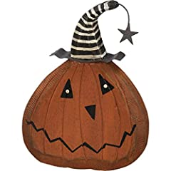 "A wooden chunky sitter featuring a spooky pumpkin face wearing a metal witch hat. Complements well with coordinating design pieces for a spooky collection. Measures 6.5"" tall X 5"" X 1"" deep. Wood, Metal and wire."