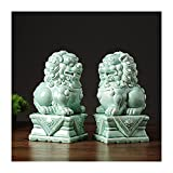 Un par de leones de cerámica con una base, Fu Foo Dogs The...