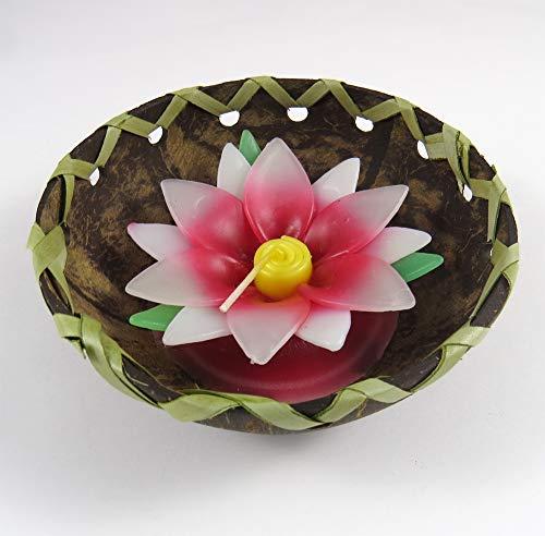 Candela profumata decorativa a forma di fiore di loto rosso in mezzo guscio di noce di cocco.