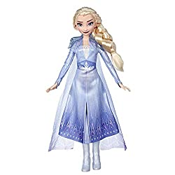 Elsa from the Disney Frozen films: A fan-favourite character from the Disney Frozen films, This Elsa doll is wearing an outfit inspired by the one seen in the Disney Frozen 2 film Light blue Film-inspired outfit: Her elegant blue ombre outfit is in t...