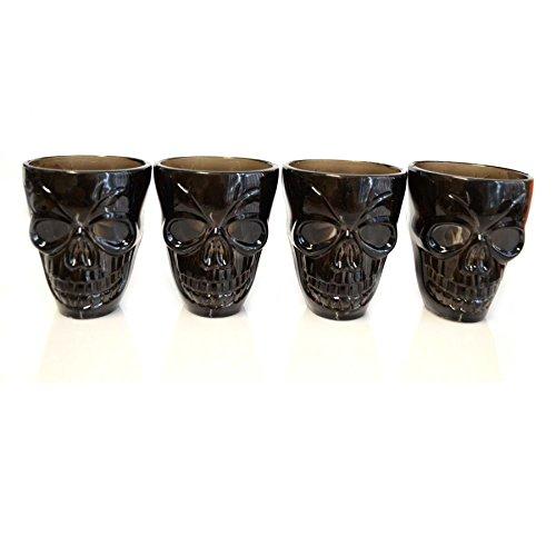 Gifts 4 All Occasions Limited SHATCHI-907 - Vasos de chupito con forma de calavera en 3D (4 unidades), color negro