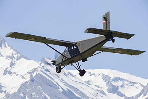 Pilatus PC-6 transport aircraft of the Swiss Air Force in flight over Switzerland. Poster Print (17 x 11)