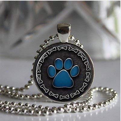 Colgante con diseño de huella de perro con borde de hueso bañado en plata con cadena negra o azul
