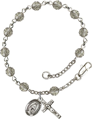 Sterling Silver Rosary Bracelet features 6mm Black Diamond Swarovski beads. The Crucifix measures 5/8 x 1/4.