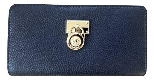 Spacious zip around wallet wrapped in soft pebbled leather with polished hardware Iconic plate and Hamilton padlock accents the front, and lays nearly flat when open Saffiano leather and logo fabric interior with 10 card slots, Interior also offers z...