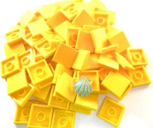 100 Stück LEGO FLIESEN /glatte Platten 2x2 Noppen in gelb. Incl. LEGO Muschel.