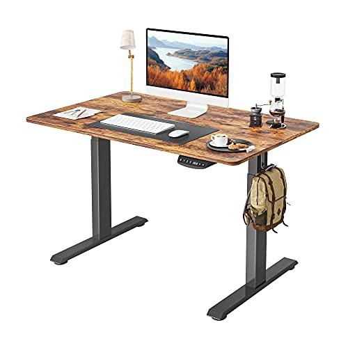 FEZIBO Escritorio eléctrico de pie de altura ajustable, 100 x 24 cm, mesa de pie, soporte para sentarse, oficina en casa, escritorio con tablero de empalme, marco negro/tapa marrón rústico