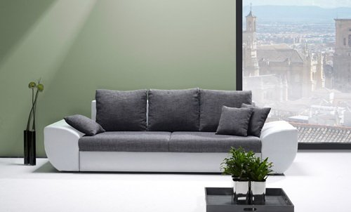 lifestyle4living Big Sofa in grau weiß mit Schlaffunktion und Bettkasten, Kunstleder | XXL Couch inkl. 3 extragroßen Rücken-Kissen und hochwertiger Wellenfederung
