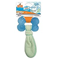 Soak and freeze the whole bone and cloth of this interactive dog toy for a cool texture with added teething relief Soft, rubbery dog toy made with material designed just for teething puppies, helps soothe sore gums Textured dog bone features soft bri...
