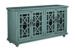 """Teal Finish Assembled product dimensions: 63"""" L x 35"""" H x 18"""" D Two (2) large cabinets feature tempered Glass doors with an elegant Trellis design and two (2) adjustable shelves for TV, audio, and video game Component storage; vertical cable manageme..."""