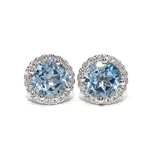 Pendientes de oro blanco de 18k para mujer con 40 diamantes auténticos talla brillante que suman de 0.23cts y 2 topacios azules de 7mm y 3.05cts.
