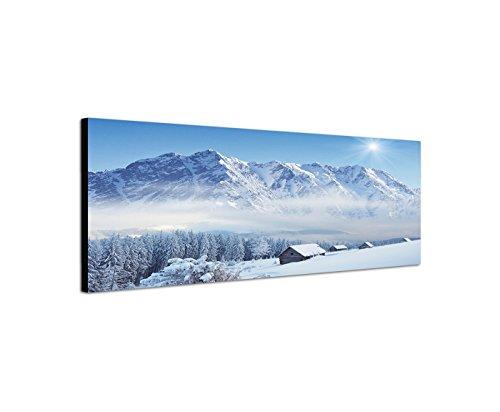 Wandbild auf Leinwand als Panorama in 150x50cm Winterlandschaft Berge Wald Häuser Schnee
