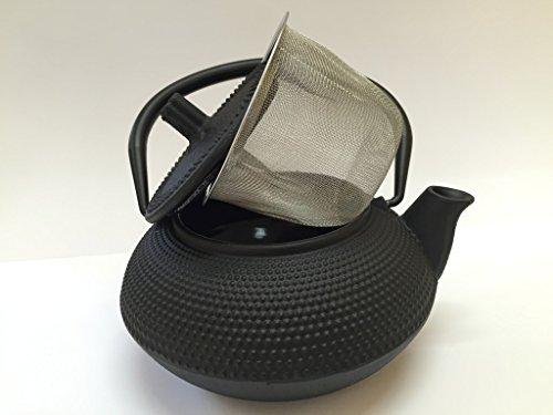 Tetera de hierro colado con filtro
