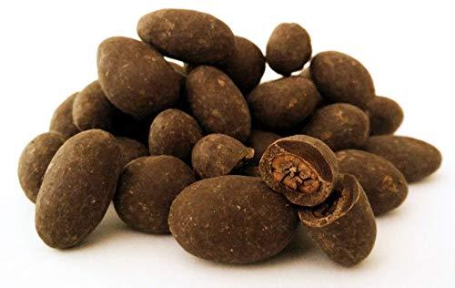 Edelmond Kakaobohnen im Schokomantel. Herbe Schokoladendrops mit nur 2 Zutaten. Bio, Vegan & Fair-Trade. Die andere Art Bitterschokolade, Herrenschokolade oder dunkle Schokolade zu genießen