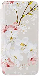 Official Ted Baker mirror folio case for the Apple iPhone SE Adorned with Ted's gossip-worthy new-season print: Oriental Blossom Complete with an electroplated back shell and flip-back folio cover Soft-feel finish with hand-crimped edges and speciali...