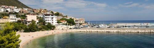 Posterazzi Buildings on the beach front Harbor Cala Gonone Nuoro Sardinia Italy Poster Print, (27 x 9)