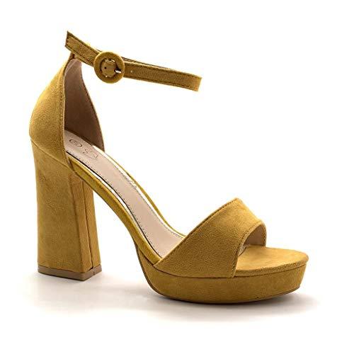 Sandalias amarillas de tacón alto y plataforma