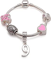 Girls Happy 9th Birthday gift for a 9 year old girl. Pink silver plated charm bracelet The Birthday gift set features Pink Sparkle Butterfly, Silver Plated Round Happy Birthday, '9' drop charm, Pink Candy Heart and Pink Diamante clip Available in dif...