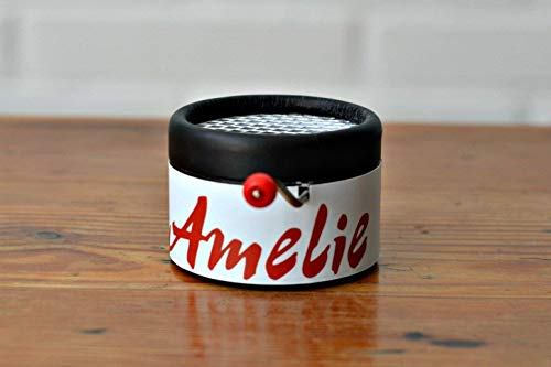 Hand cranked music mechanism with the main theme of the film: Amelie`s Vals in a gift packaging