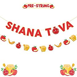 Banners on strings to decorate for Rosh Hashanah. Shana Tova and images of apples, pomegranates, honey, shofars