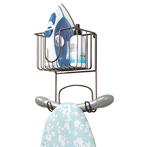 mDesign Wall Mount Metal Ironing Board Holder with Small Storage Basket - Holds Iron, Board, Spray Bottles, Starch, Fabric Refresher for Laundry Rooms - Bronze