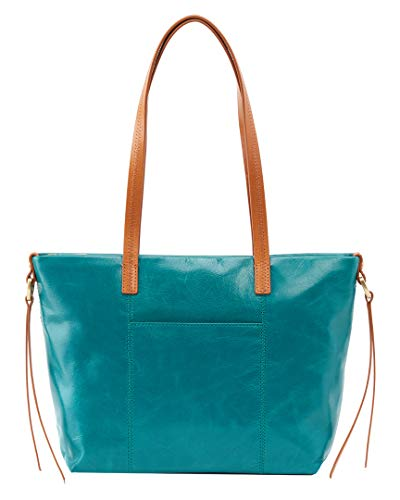 Keep your essentials close and your style up to par with the chic Cecily mini-tote! Mini top-handle tote made from leather. Top zip closure. Front and back exterior slip pockets. Flat base for upright structure. Signature Hobo printed lining varies. ...